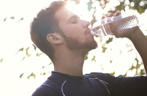 Wellness Family Dentistry Man drinking water