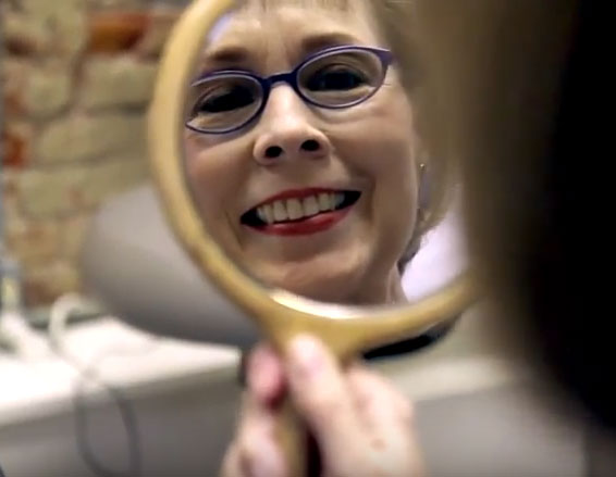 Wellness Family Dentistry | Woman Looking in Mirror